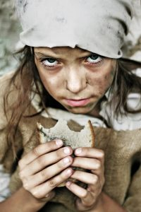 A portrait of a poor beggar child with a piece of bread in her hands. Please check for more.